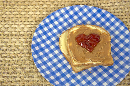 peanut butter and jelly: jelly heart on a peanut butter sandwich