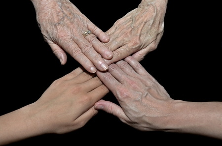 four hands: four hands representing family generation