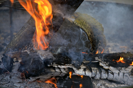 smoldering: close up of a flames and ashes in bonfire