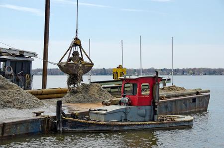 dredging: dredging a marina slip Stock Photo