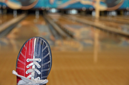 shoe strings: bowling shoe with bowling alley background Stock Photo