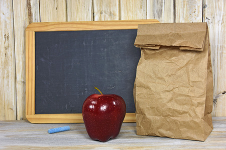 apple paper bag: brown paper bag and red apple with chalkboard Stock Photo