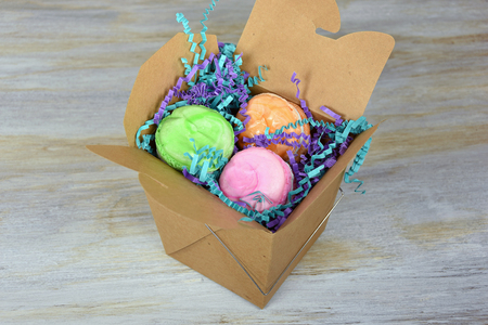 out of the box: French macaroons in brown take out box Stock Photo
