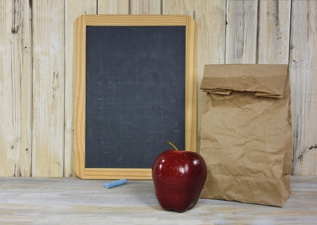 apple sack: brown paper sack with red apple and chalkboard