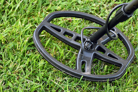 metal detector: metal detector on grass Stock Photo