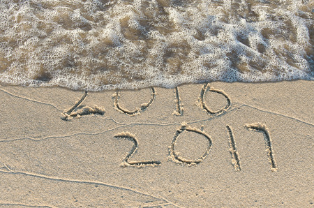 New Year 2017 written in beach sand with surf