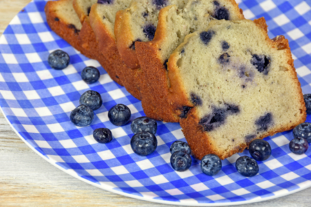sliced blueberry bread on blue and white checkered plate