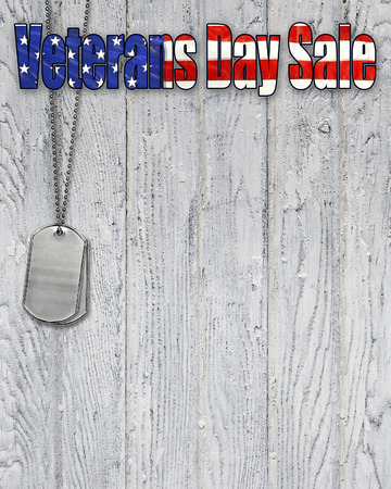 Veterans Day sale sign with military dog tags on wood Stock Photo