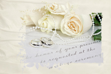 wedding roses and rings on wedding invitation