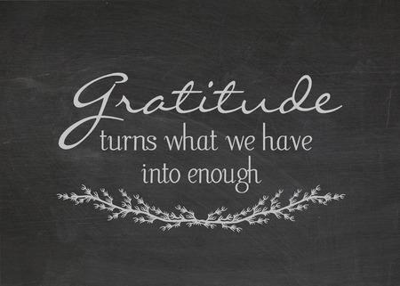 gratitude quote on dusty black chalkboard Фото со стока