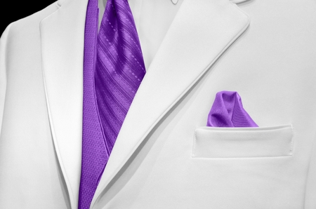 bold: white tuxedo with bold purple tie Stock Photo