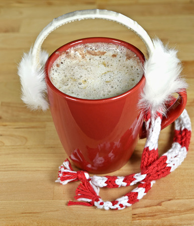 hot chocolate drink: hot chocolate drink with white fur earmuffs and scarf