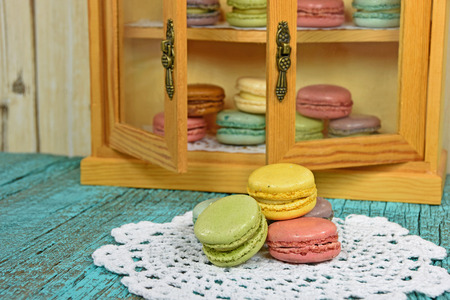 French macaroons on doily and in glass pantry