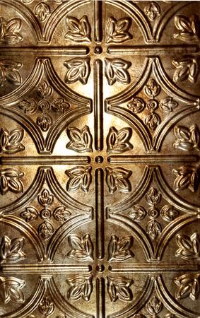 vintage tin tile background with bronze hue