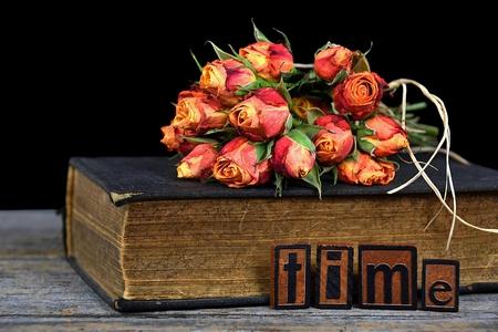 letterpress: rose bouquet on vintage book with letterpress tile