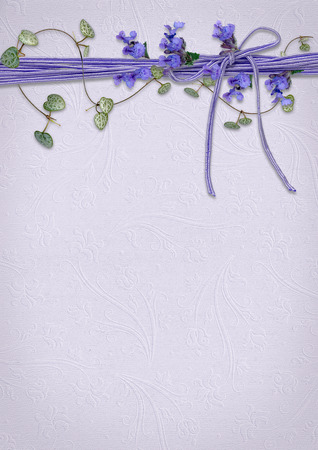purple flowers and ivy on ribbon border with embosses background Zdjęcie Seryjne
