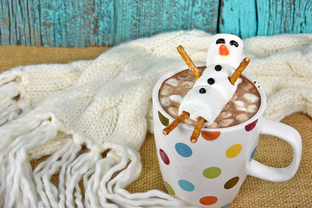 hot chocolate drink: hot chocolate drink and marshmallow snowman in mug Stock Photo