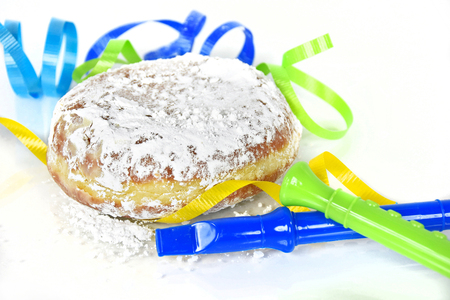fat tuesday: paczki with party horns and ribbon for Fat Tuesday Stock Photo