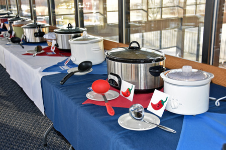 crock: row of crock pots for chili cook off contest in restaurant