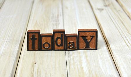 letterpress type: word today in vintage wooden letterpress type on wood