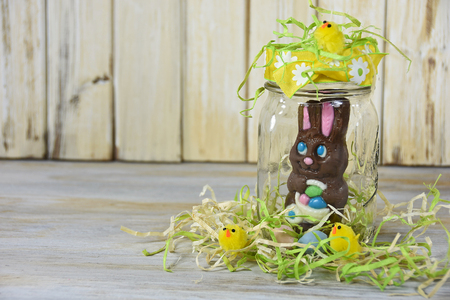 chocolate Easter bunny in mason jar with yellow chicks and eggs