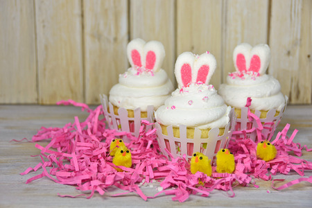 bunny ears in Easter cupcakes with yellow chicks