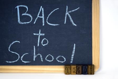 letterpress type: word teach in letterpress type with back to school sign on chalkboar Stock Photo