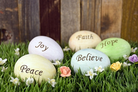 message: Easter eggs in grass with inspirational message Stock Photo