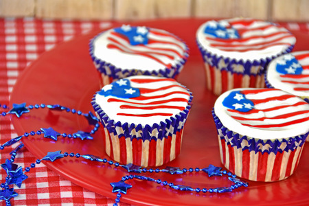 patriotic flag cupcakes with star necklace on red plate