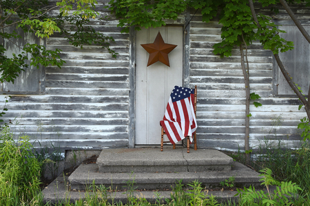 stoop: American flag by old house door with star