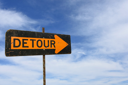 detour sign with wispy clouds in summer sky