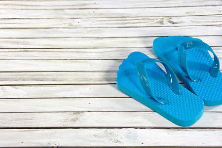 whitewashed: turquoise flip-flops on whitewashed wooden deck Stock Photo