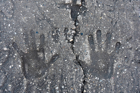 hand print: hand print indentation in concrete with crack Stock Photo
