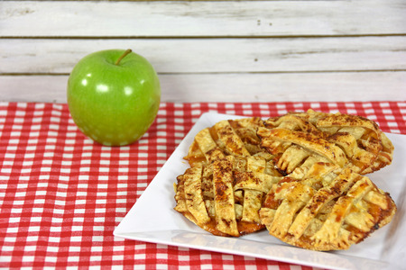 apple pie cookies on white square plate with green apple Stock Photo