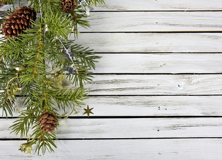 bough: pine bough with gold and silver Christmas stars on gray wood