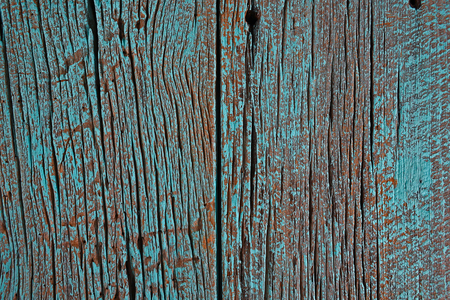 painted wood: rustic barn wood painted in bright turquoise paint Stock Photo