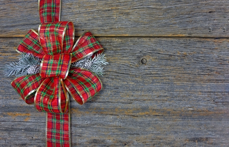 red plaid: red plaid Christmas bow on rustic barn wood