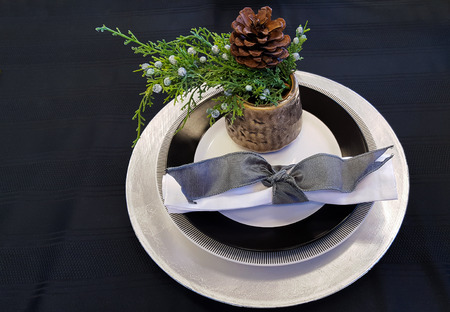 table decoration: evergreen spruce in cup on Christmas place setting