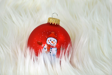 red Christmas ornament with snowman in fur
