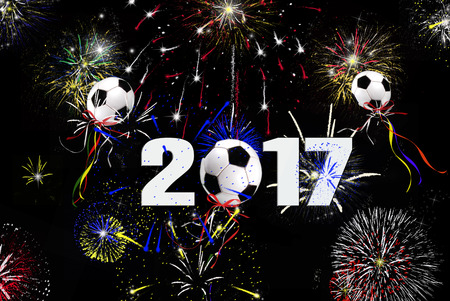 soccer: New Year 2017 soccer ball balloons in sky with fireworks