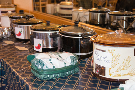 row of crock pots in chili cook off contest