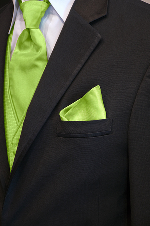 black tuxedo with bright green tie and handkerchief in pocket Imagens