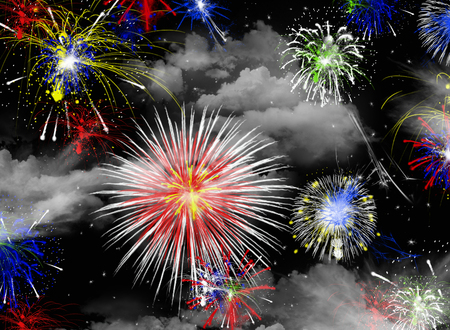 Fireworks in black sky with clouds and stars Stock Photo