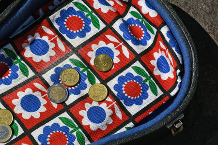 Euro coin tip money in colorful guitar case on street Stock Photo