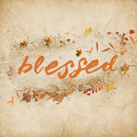 word blessed in orange text color with autumn leaves on textured background