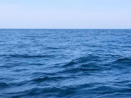 blue wavy Lake Michigan water with horizon Stock Photo
