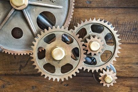 old mechanical gears on wood