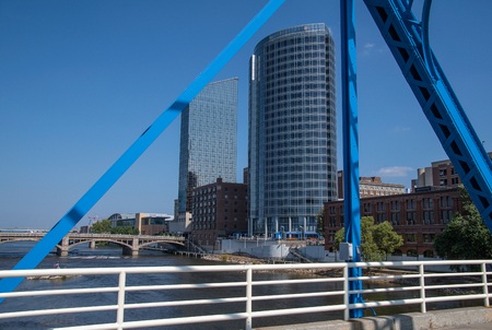 city building framed in blue steel bridge structure in Grand Rapids Michigan Stock Photo