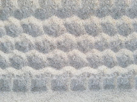 wavy tire track pattern in beach sand Stock Photo