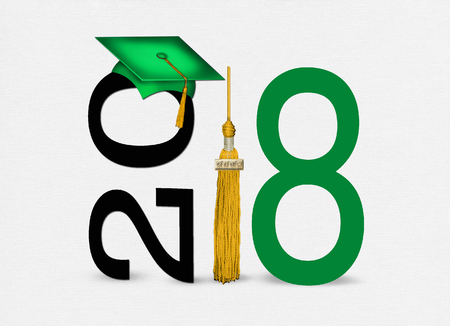 gold tassel with green graduation hat for class of 2018 on soft textured white background Stock Photo